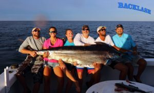 group of fishers with a blue marlin